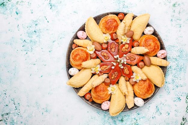 Traditional azerbaijan holiday novruz cookies baklavas and shakarburas on black tray plate Premium P
