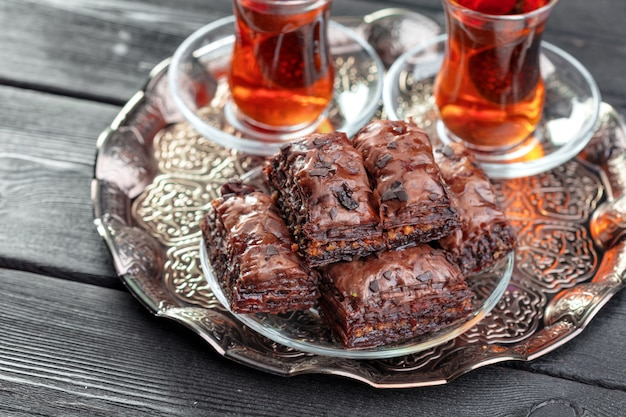Traditional baklava on wooden table Premium Photo
