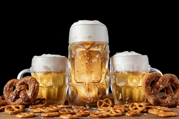 Traditional bavarian beer and pretzels on a table Free Photo