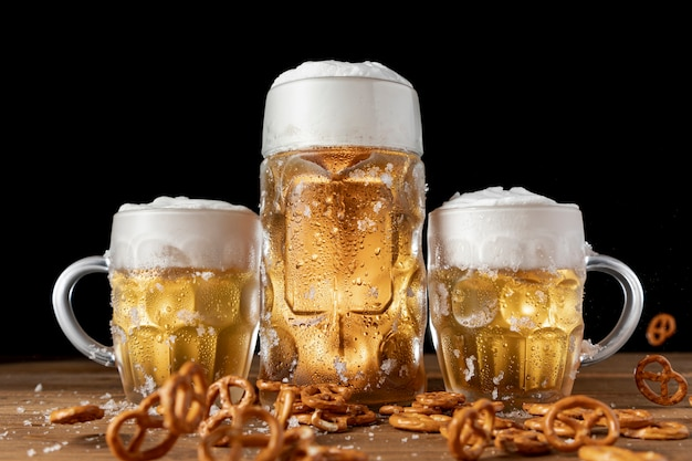 Traditional bavarian beer with pretzels on a table Free Photo