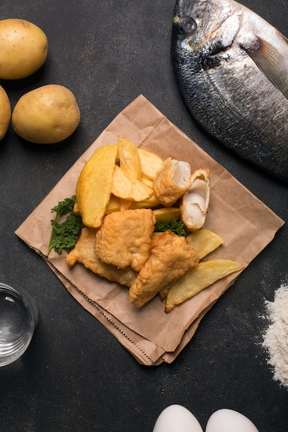 Traditional british fish and chips on the dark surface Premium Photo