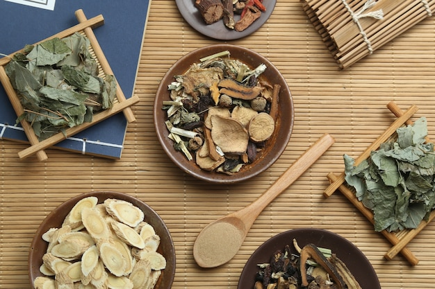 Traditional chinese medicine and ancient medical book on bamboo Free Photo