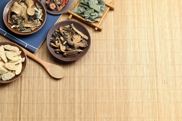 Traditional chinese medicine on bamboo desk Free Photo