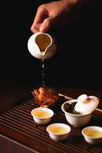 The traditional chinese tea ceremony is perfomed by tea master. Free Photo