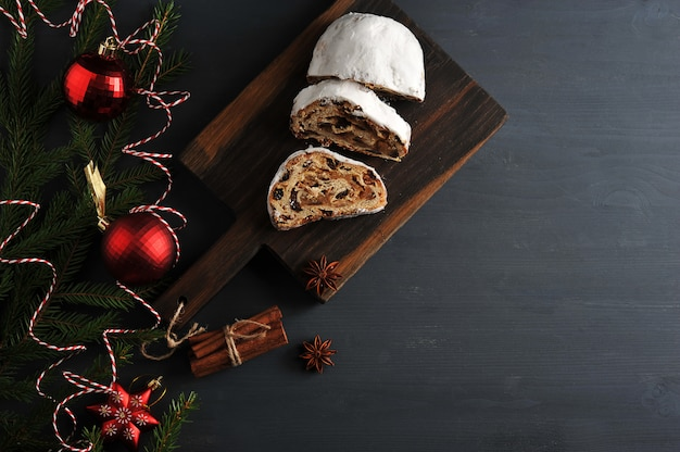 Traditional christmas cake with raisins and nuts with tree branches and toys Premium Photo
