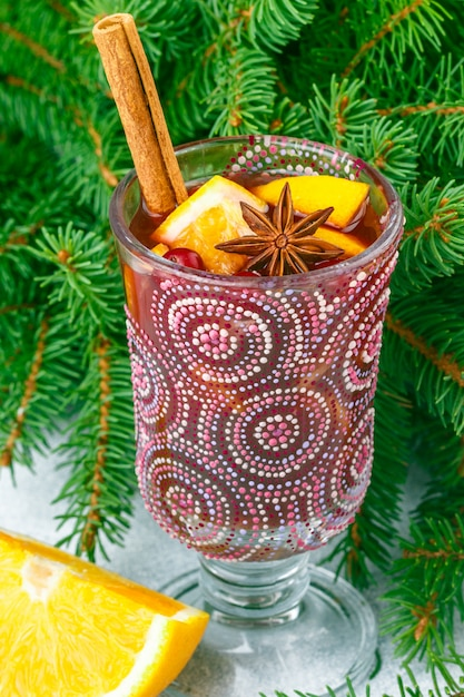 Traditional christmas mulled red wine with spices (cinnamon, star anise, cardamom) and fruits Premium Photo