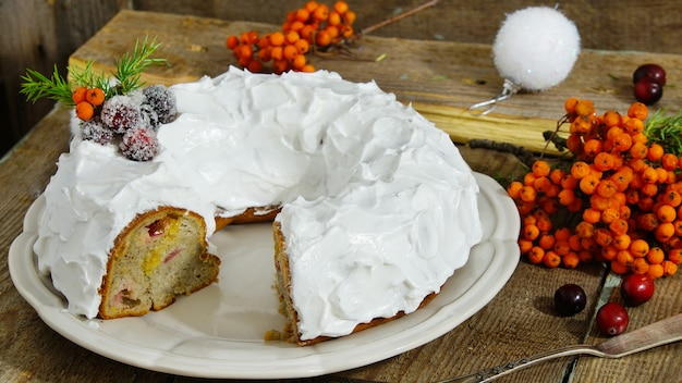 Traditional christmas and new year cake with cranberries and frosting Premium Photo