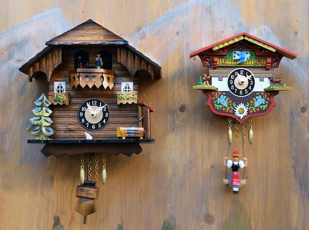 Traditional colorful wooden cuckoo clocks Premium Photo