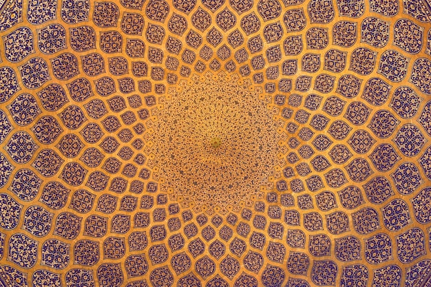 Traditional decoration of the ceiling in an ancient mosque Premium Photo