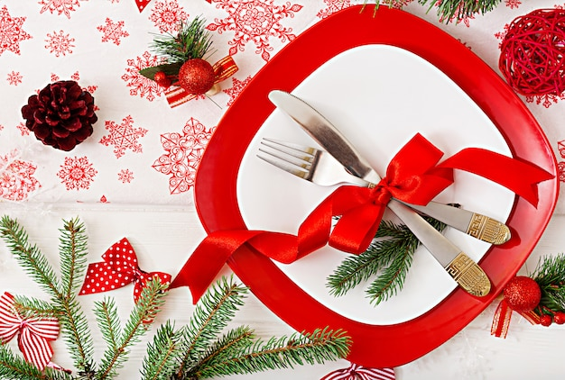 Traditional dishware on christmas table. flat lay. top view Free Photo