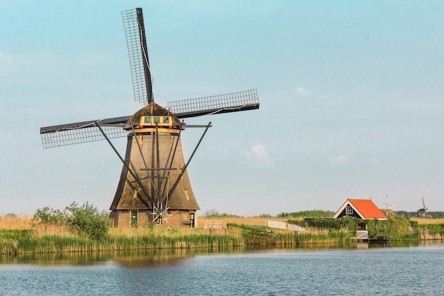 Traditional dutch windmills with green grass in the foreground, the netherlands Free Photo