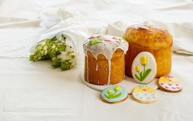 Traditional easter cake, kulich, easter cake and cookies with royal icing Premium Photo