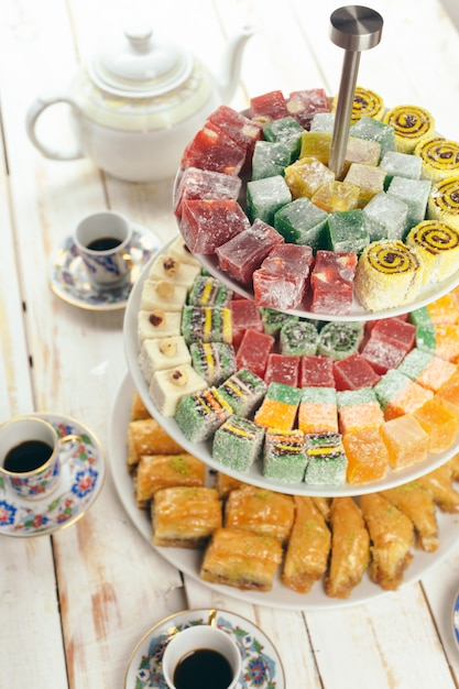 Traditional eastern desserts on wood Premium Photo