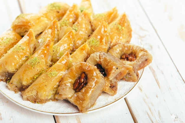 Traditional eastern desserts on wooden surface Premium Photo