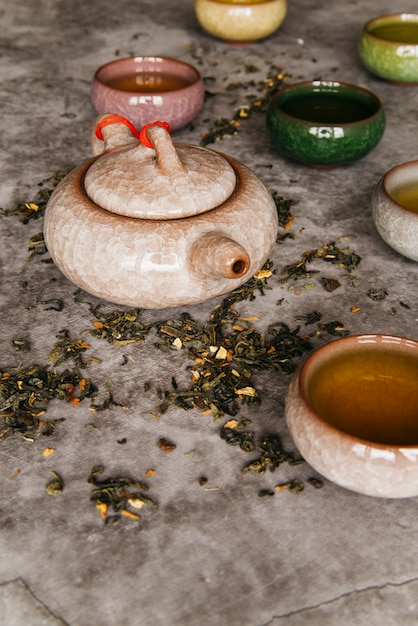 Traditional eastern teapot and teacups on concrete background Free Photo