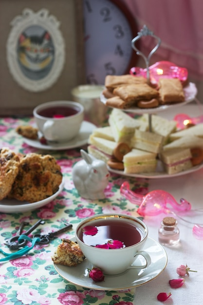 Traditional english tea party in a fabulous decoration. rustic style. Premium Photo