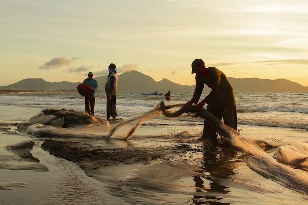 Traditional fishermen catch fish in the sea Premium Photo