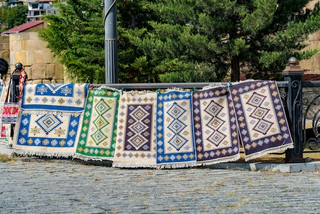Traditional georgian carpets and kilim rugs with typical geometrical patterns in tbilisi georgia europe Premium Photo