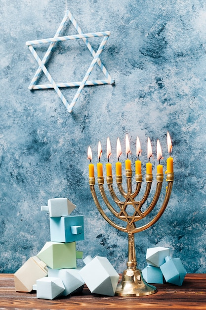 Traditional hanukkah candles on a table Free Photo