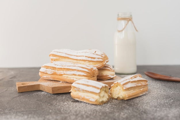 Traditional homemade eclairs with milk bottle Free Photo