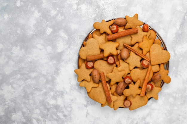 Traditional homemade gingerbread cookies on grey concrete  ,close up,christmas ,top view,flat lay Free Photo