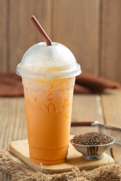 Traditional iced milk tea and red tea powder. Free Photo