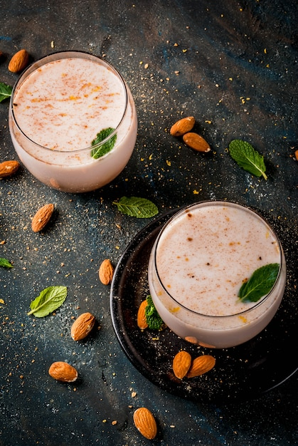 Traditional indian beverage, holi festival food, thandai sardai milk drink with nuts, spices, mint. Premium Photo
