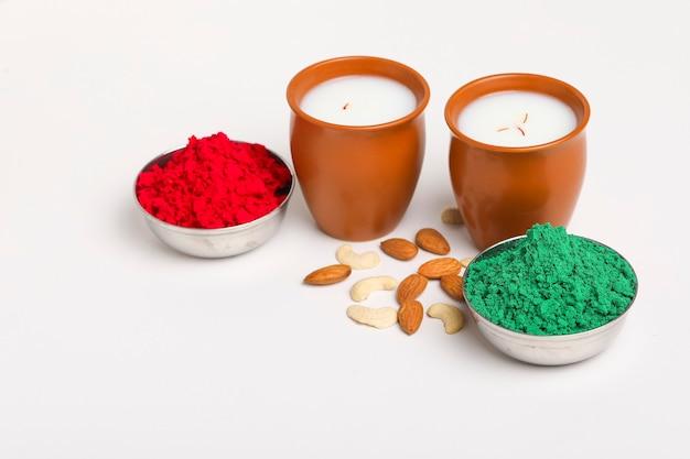 Traditional indian beverage, holi festival food, thandai sardai milk drink with nuts, Premium Photo