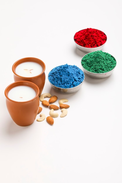 Traditional indian beverage, holi festival food, thandai sardai milk drink with nuts, Premium Photo