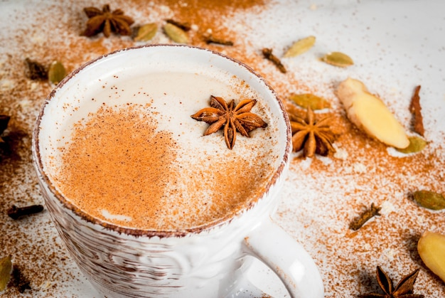Traditional indian masala chai tea with spices  cinnamon, cardamom, anise, white . copyspace Premium Photo