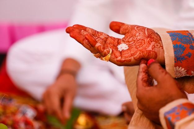 Traditional indian wedding ceremony, groom hand Premium Photo