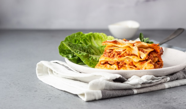 Traditional italian lasagna with minced meat, tomato and cheese Premium Photo