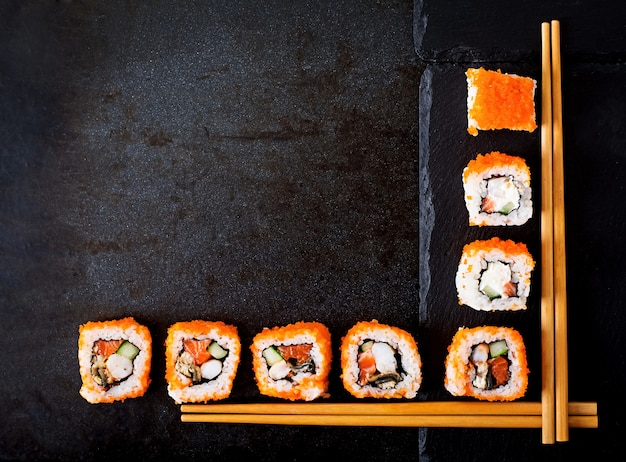 Traditional japanese food - sushi, rolls and chopsticks for sushi. top view Free Photo