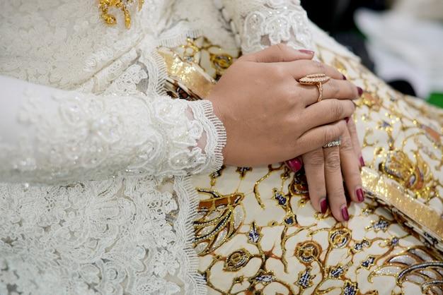 Traditional javanese woman hands wearing batik Premium Photo