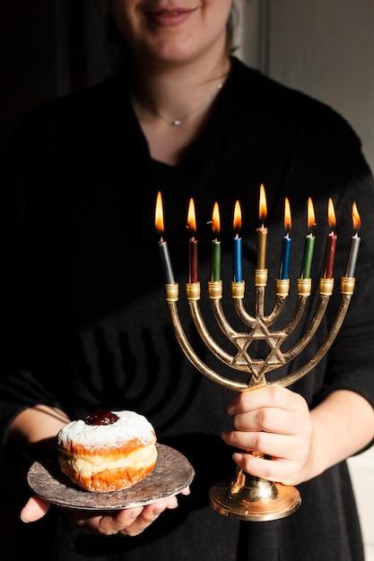 Traditional jewish menorah and a donut Free Photo