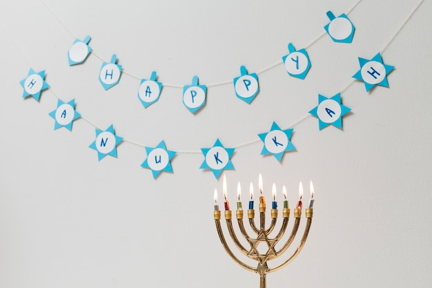 Traditional jewish menorah with candles Free Photo
