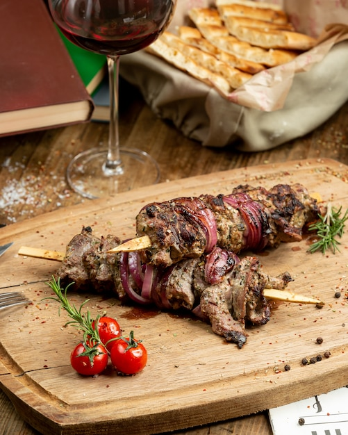 Traditional kebab on the wooden board Free Photo
