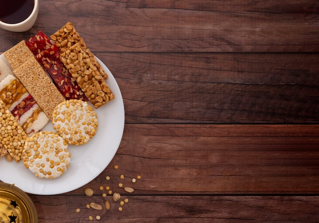Traditional mawlid sweets on brown wooden table, copyspace for text Premium Photo