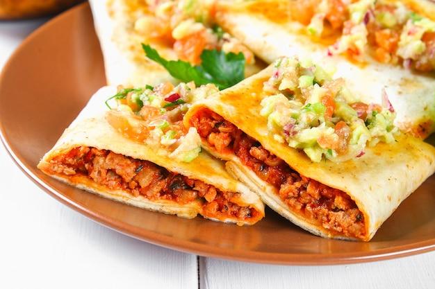 Traditional mexican dish - chimichanga. Premium Photo