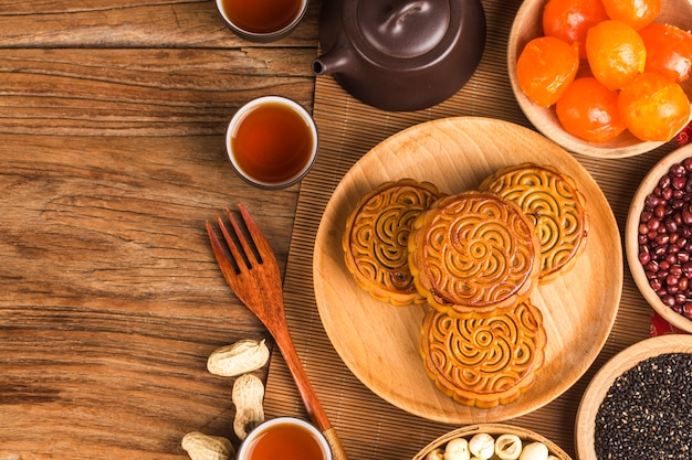 Traditional mooncakes on table setting with teacup. Premium Photo
