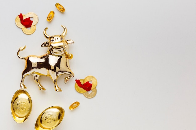 Traditional new year chinese ox and golden objects Free Photo