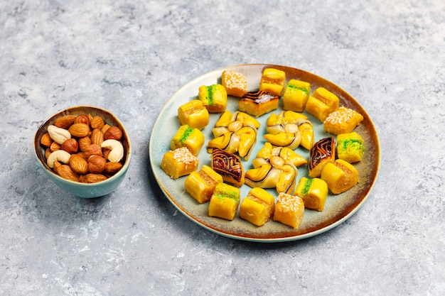 Traditional oriental sweets with different nuts on concrete surface Free Photo
