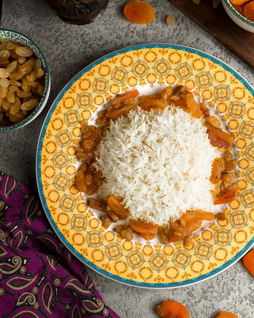 Traditional rice served with sour fruits Free Photo
