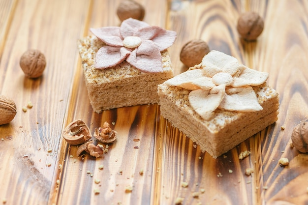Traditional russian dessert - pastila and hazelnuts on rustic wooden background. Free Photo