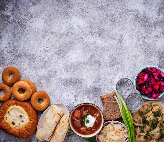 Traditional russian dishes, sweets and vodka Premium Photo