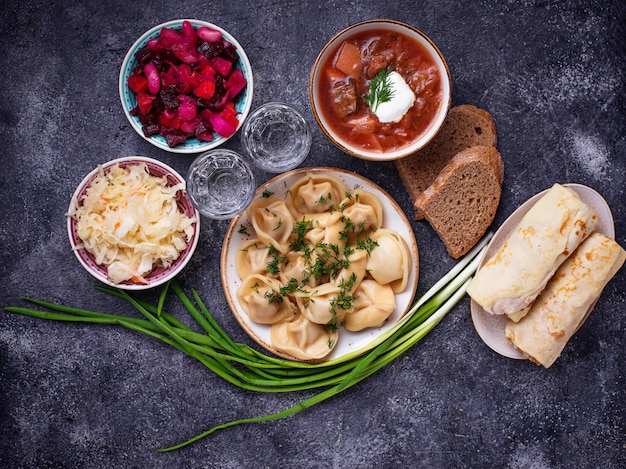Traditional russian dishes and vodka Premium Photo