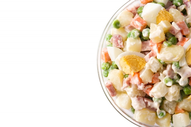 Traditional russian salad, olivier salad isolated on white. top view. Premium Photo