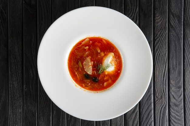 Traditional russian solyanka soup Premium Photo