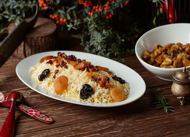 Traditional shah plov with dry fruits and nuts. Free Photo
