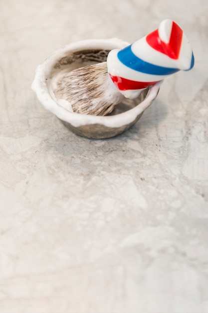 Traditional shave brush and bowl with foam Free Photo